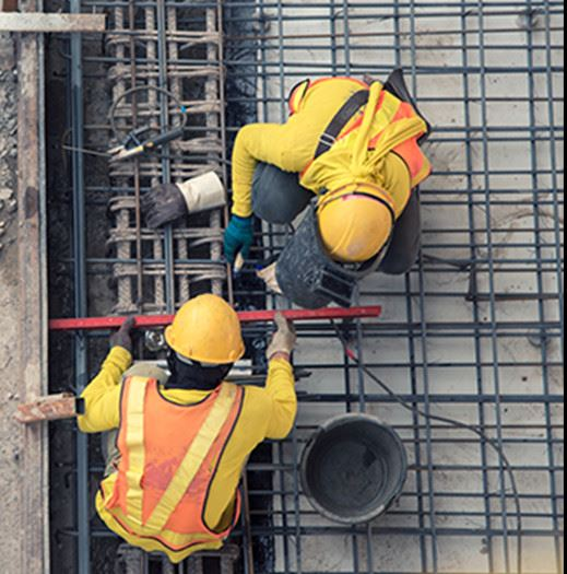 Construction Workers Measuring