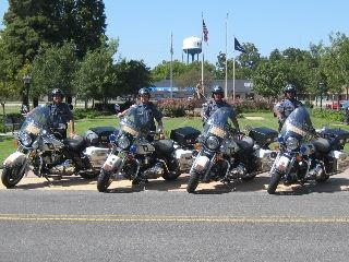 Four police officers on motorcycles